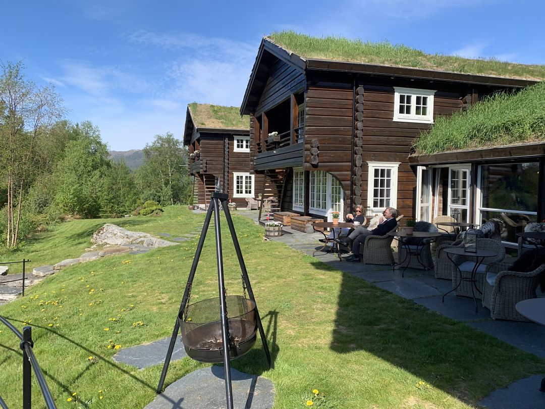 Relaxing in the garden of the luxury lodge. Luxury vacation Norway